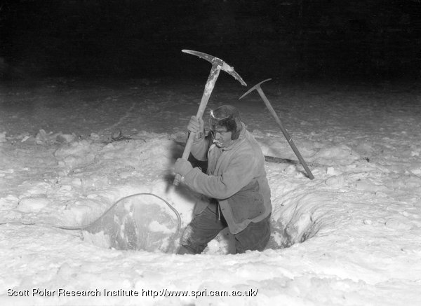 Mr H.G. Ponting making a hole in four feet of sea ice for lowering the fish trap. January 26th 1911
