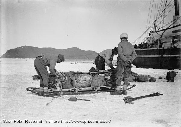 "Loading sledges by the ""Terra Nova"""