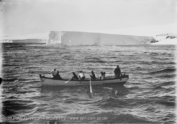 Berg aground near Cape Evans. Boat coming off. Terra Nova aground. Jan. 20th 1911.