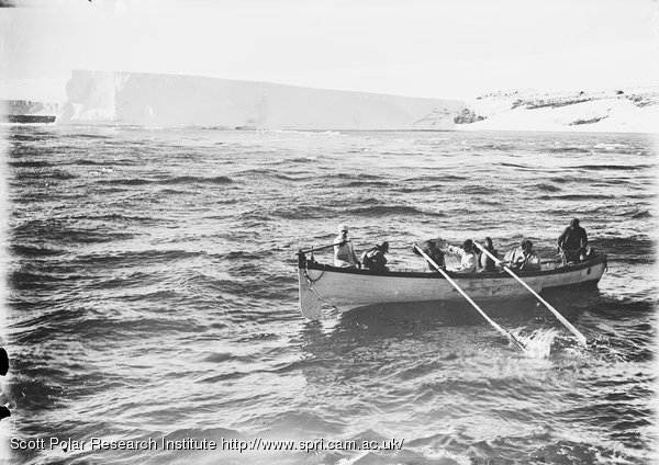 Stranded berg and boat coming off. Jan. 20th 1911.