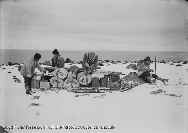 Packing a sledge at top of moraine for trip to Shackleton's. Feb. 11th 1911.