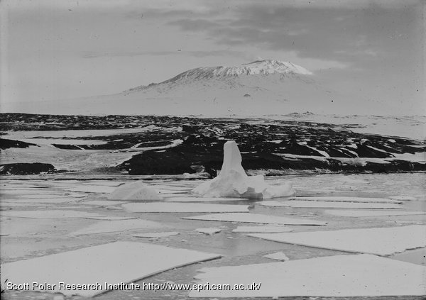 Backdoor Bay. Cape Royds showing sharp line of shadow on Erebus. Feb. 16th 1911.