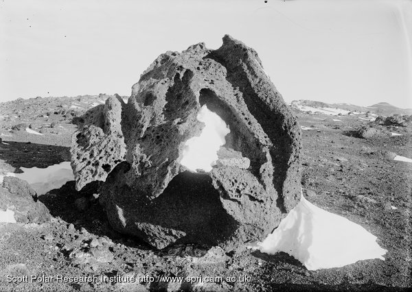 Weathered Kenyte boulder near house. March 8th 1911