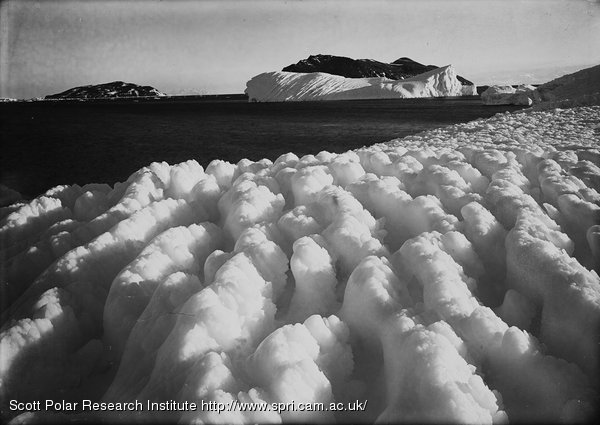 Spray ridges of ice. Cape Evans. Inaccessible Island in distance. March 8th 1911