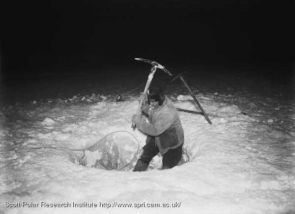 Herbert Ponting making a hole in 4 feet of sea-ice for the purpose of lowering the Fish-trap. June 26th 1911
