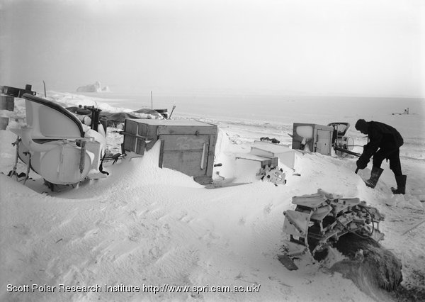 Bernard Day digging out the snowed up motor tractors. August 1st 1911