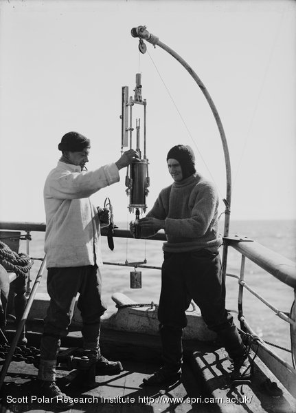 Nelson and Lilley taking sample from bottle. Jan. 1st 1911.