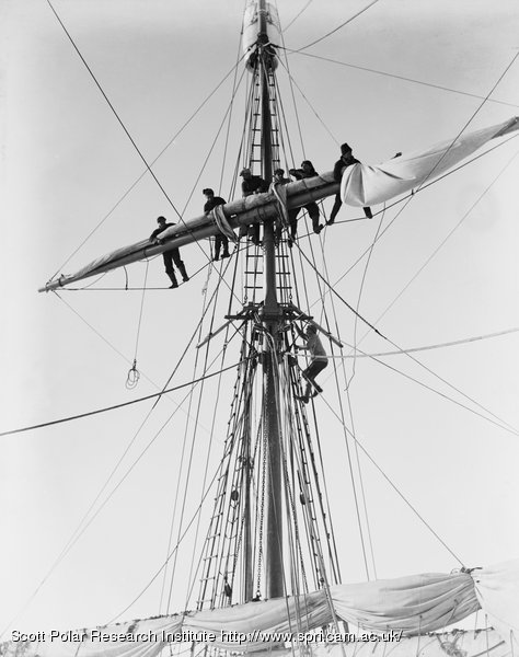 Furling the upper topsail of the Terra Nova in the pack